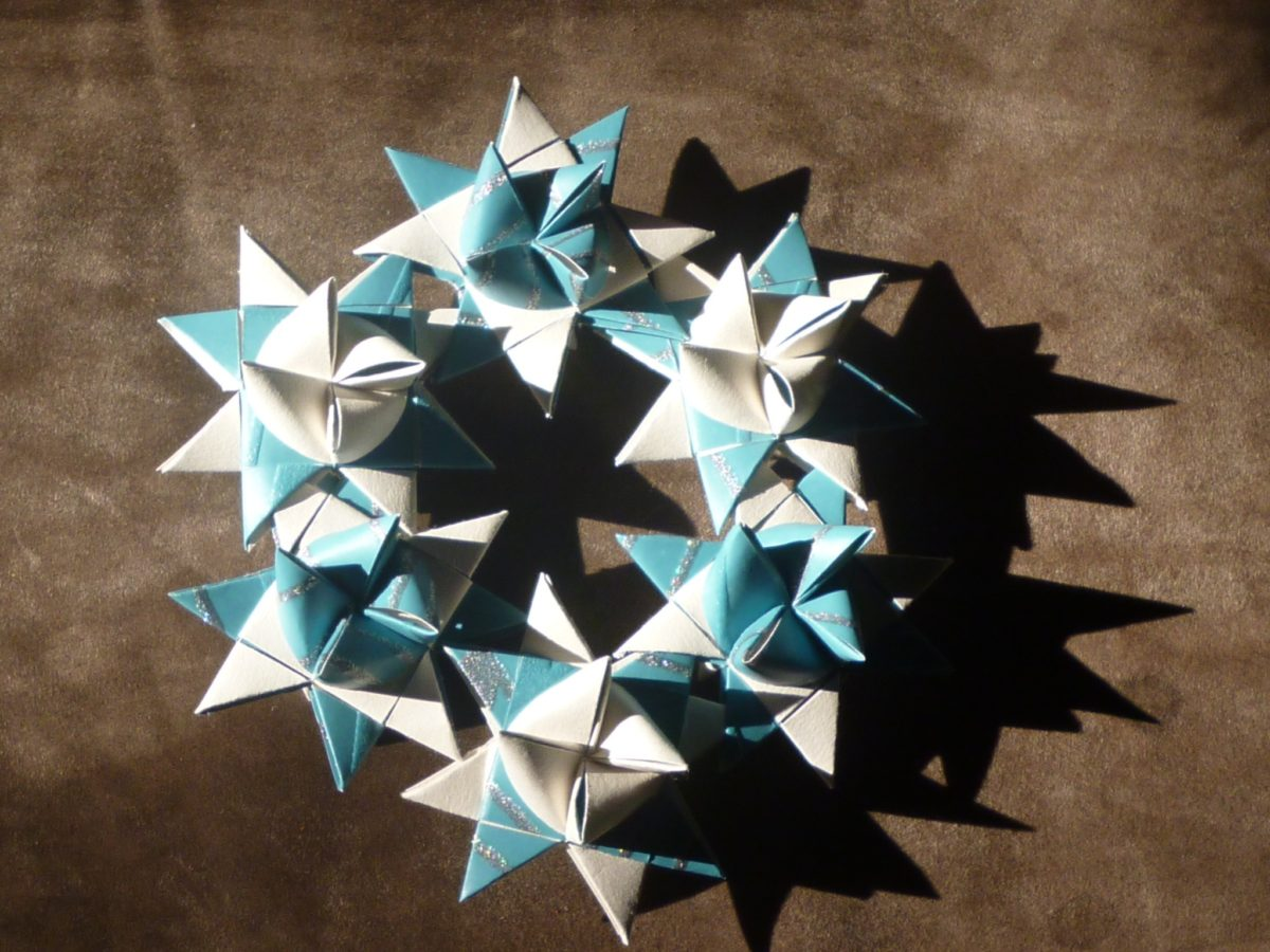 Christmas Origami Star Wreath made from blue, white and silver Froebel stars.